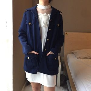 Bodin Knits navy blue coat with gold button.